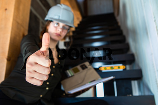Woman inspector reviewing stairs