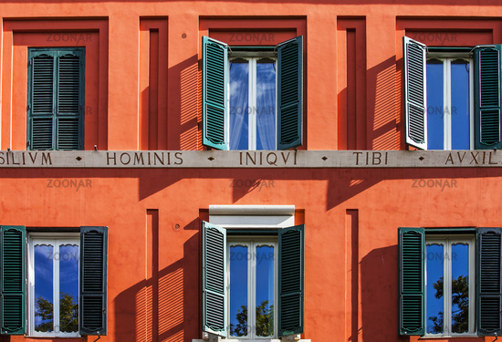 Window with shutters on a house facade in Rome Lazio Italy