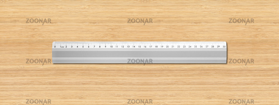 Metal ruler isolated on wooden background
