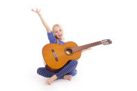 young happy girl with guitar