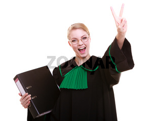 Law court or justice concept. Young woman lawyer attorney wearing classic polish (Poland) black green gown with file folder or dossier victory sign hand gesture celebrating success isolated on white background
