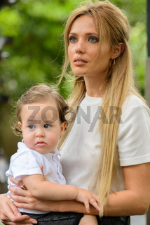 Young beautiful blonde mother with adorable baby son together