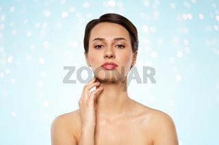 beautiful young woman touching her neck