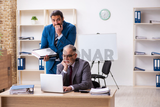 Two male colleagues working in the office