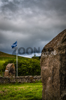 Scottish Flag and Carved Stones Marking the Border Between Scotland and England