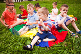 The cute kids have a snack in the park