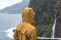 Woman looking at Bridal Veil Falls veu da noiva in Madeira, Portugal