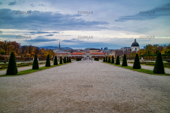 The main walking alley before Unteres Belvedere in Vienna on a background of cloudy sky.