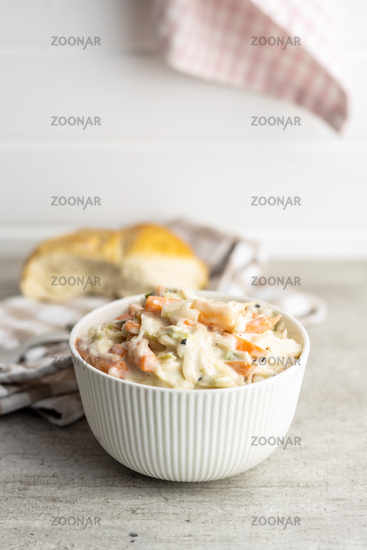 Coleslaw. Salad made of shredded white cabbage and grated carrot with mayonnaise.