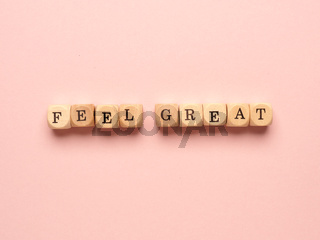 Feel great written with small wooden blocks