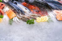 Fresh seafood on ice background.