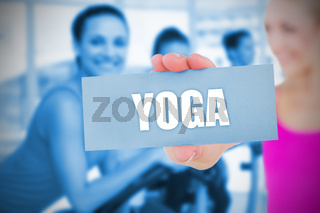 Fit blonde holding card saying yoga