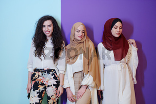 muslim women in fashionable dress isolated on colorful background