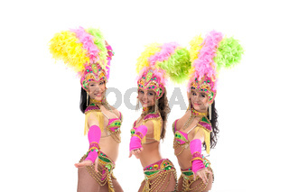 Trio of artistic samba dancers smiling at camera