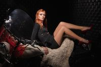 Nice red-haired woman posing in the studio
