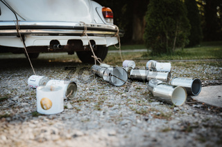photo of cans behind a wedding car
