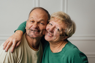 Elderly couple hugging and smiling. Happy loving caring people. Caucasian retired man and woman. valentines day