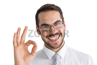 Happy businessman making okay gesture