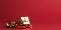 Christmas decoration in gold on a red paper background with space for text