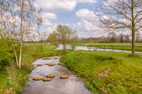 Landscape with steppjng stones in the river Regge in the Netherlands