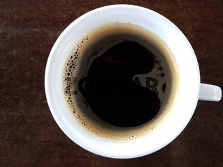 Close Up Of Black Coffee On Wooden Table Horizontal Shot