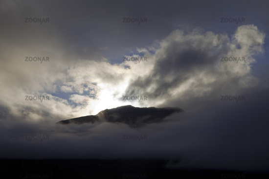 Sun and clouds on Sandfell Mountain, East Iceland, Iceland, Europe
