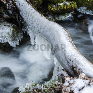 Frozen icicles on water flow