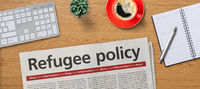Newspaper on a desk -  Refugee policy