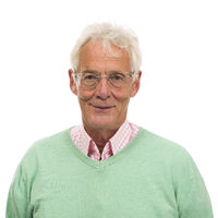 Senior man in green sweater