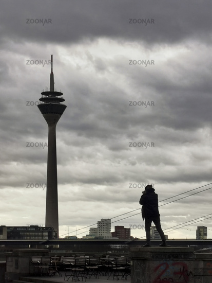 Photographer on a wall in front of the WDR tower