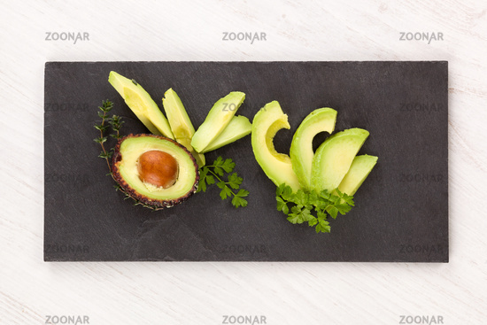 Fresh ripe avocado slices appetizer.
