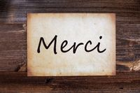 Old Paper, Merci Means Thank You, Wooden Background