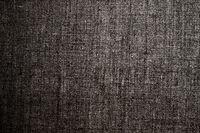 Decorative dark linen fabric textured background for interior, furniture design and art canvas backdrop