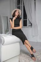 Beautiful lady sitting on a sofa