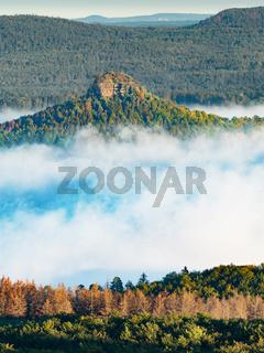Zirkelstein shinning above mist. Sandstone block