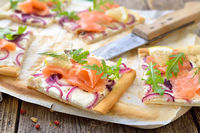 Tarte flambée with salmon and rocket