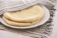 Uncooked flatbread on plate