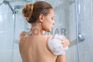Young woman have shower in domestic bathroom