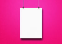 White poster hanging on a pink wall with clips