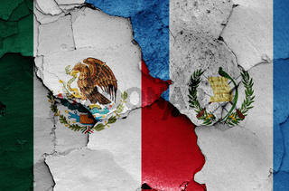 flags of Mexico and Guatemala painted on cracked wall