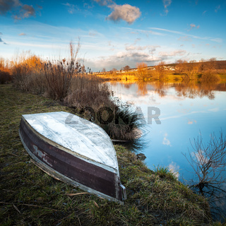 Boat on the shore of a small lake in Eisenstadt Burgenland