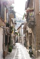 Narrow alley with apartments in an Italian old town
