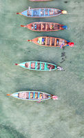 Wooden long tail boats of Thailand. Overhead aerial view from drone