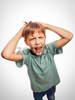 Boy child upset angry shout produces evil face portrait emotion