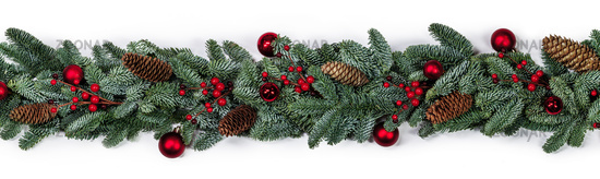 Christmas fir and decorations on white
