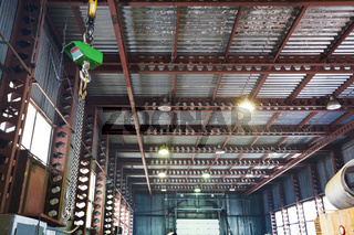 hoist with bridge crane and scales in warehouse