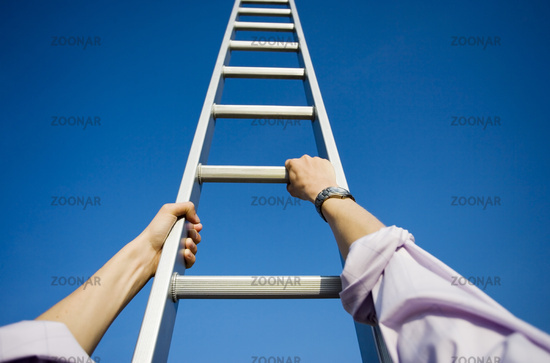 Personal perspective of a businessman climbing a ladder themes of point of view success motivation