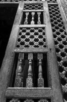 Angle view of wooden carved decorations of interleaved wooden door - Mashrabiya