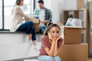 sad girl moving to new home with her family