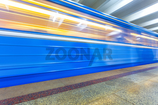Subway train in motion at the underground station